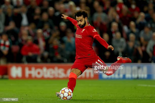 Mohamed Salah of Liverpool FC shoots a penalty kick during the UEFA Champions League group B match between Liverpool FC and AC Milan at Anfield on...
