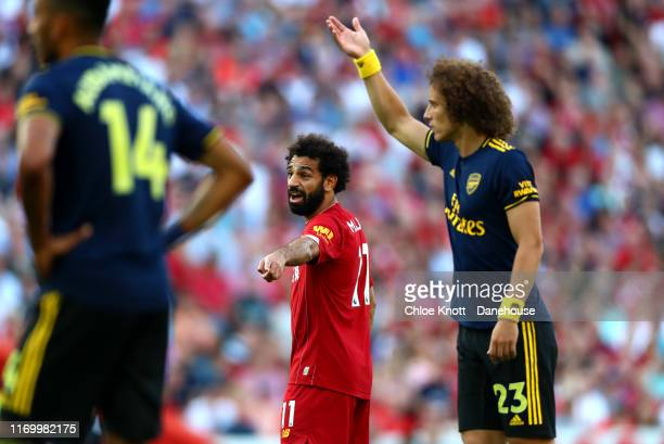 Mohamed Salah of Liverpool gestures during the Premier League match between Liverpool FC and Arsenal FC at Anfield on August 24 2019 in Liverpool...