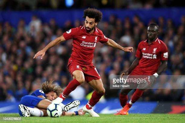 Mohamed Salah of Liverpool gets away from challenge from David Luiz of Chelsea during the Premier League match between Chelsea FC and Liverpool FC at...