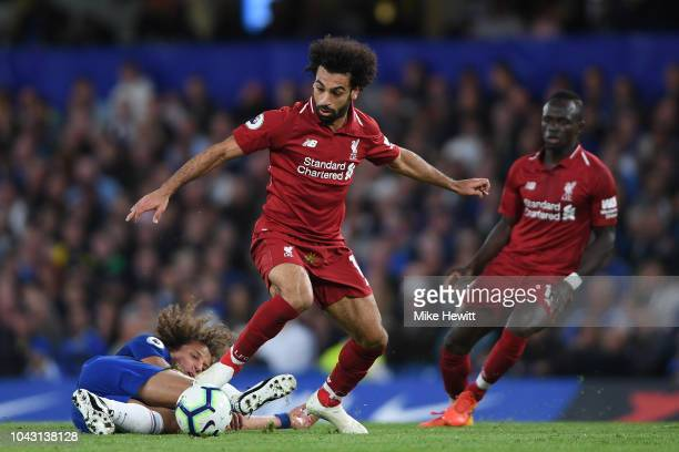 Mohamed Salah of Liverpool gets past David Luiz of Chelsea during the Premier League match between Chelsea FC and Liverpool FC at Stamford Bridge on...