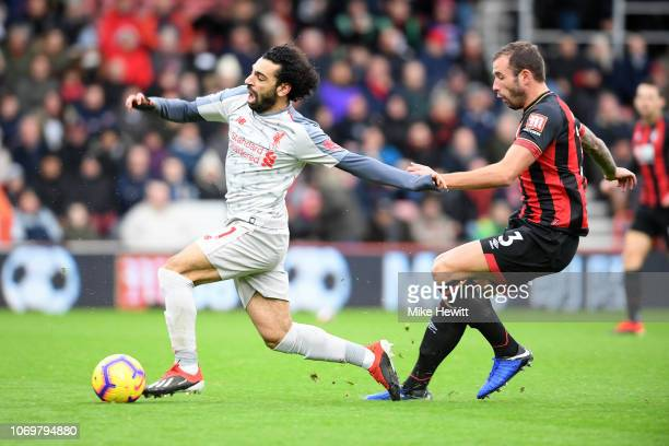 Mohamed Salah of Liverpool gets past Steve Cook of AF Bournemouth and goes on to score his team's second goal during the Premier League match between...
