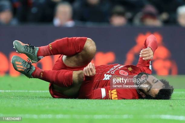 Mohamed Salah of Liverpool goes down injured during the Premier League match between Liverpool FC and Manchester City at Anfield on November 10 2019...