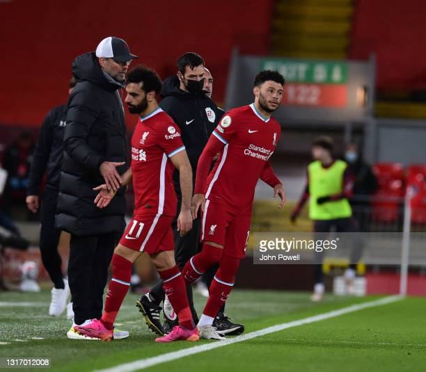 Mohamed Salah of Liverpool goes off and Alex Oxlade-Chamberlain of Liverpool comes on during the Premier League match between Liverpool and...
