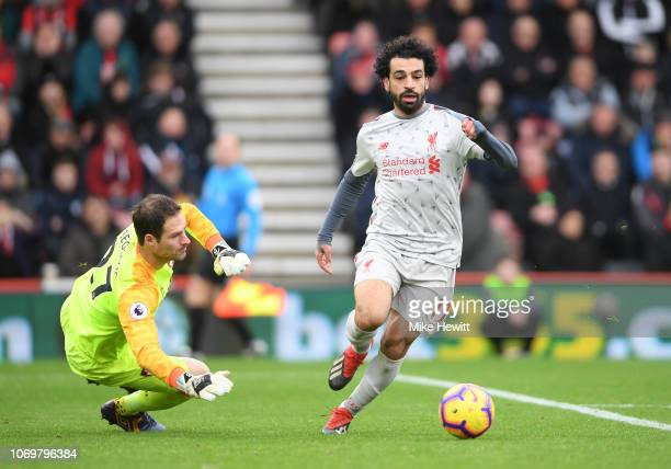 Mohamed Salah of Liverpool goes past Asmir Begovic of AFC Bournemouth and goes onto to score his sides his hatrick and his sides fouth goal during...