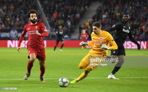Mohamed Salah of Liverpool goes past Cican Stankovic of Red Bull Salzburg before he scores his team's second goal during the UEFA Champions League...