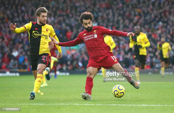 Mohamed Salah of Liverpool goes past Kiko Femenia of Watford on his way to scoring the first goal during the Premier League match between Liverpool...