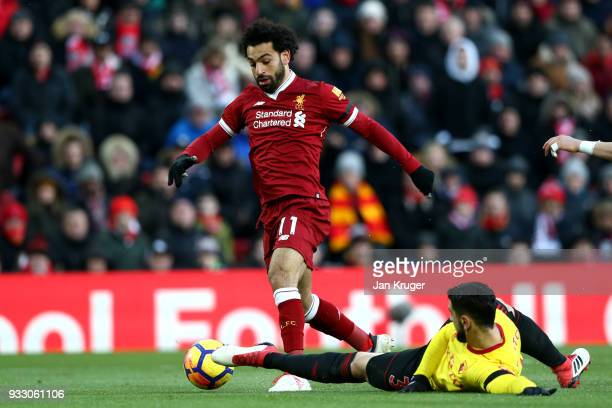Mohamed Salah of Liverpool goes past Miguel Britos of Watford to score his side's first goal during the Premier League match between Liverpool and...