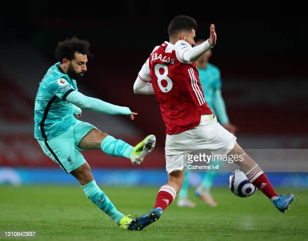 Mohamed Salah of Liverpool has a shot blocked by Dani Ceballos of Arsenal during the Premier League match between Arsenal and Liverpool at Emirates...