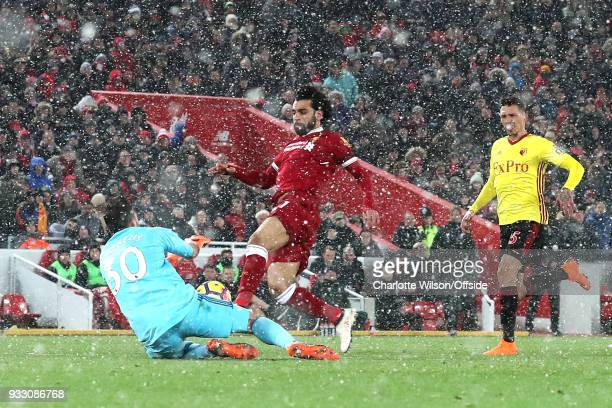 Mohamed Salah of Liverpool has his shot saved by Watford goalkeeper Orestis Karnezis during the Premier League match between Liverpool and Watford at...