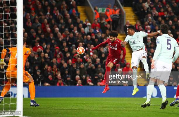Mohamed Salah of Liverpool heads wide of goal during the UEFA Champions League Round of 16 First Leg match between Liverpool and FC Bayern Muenchen...