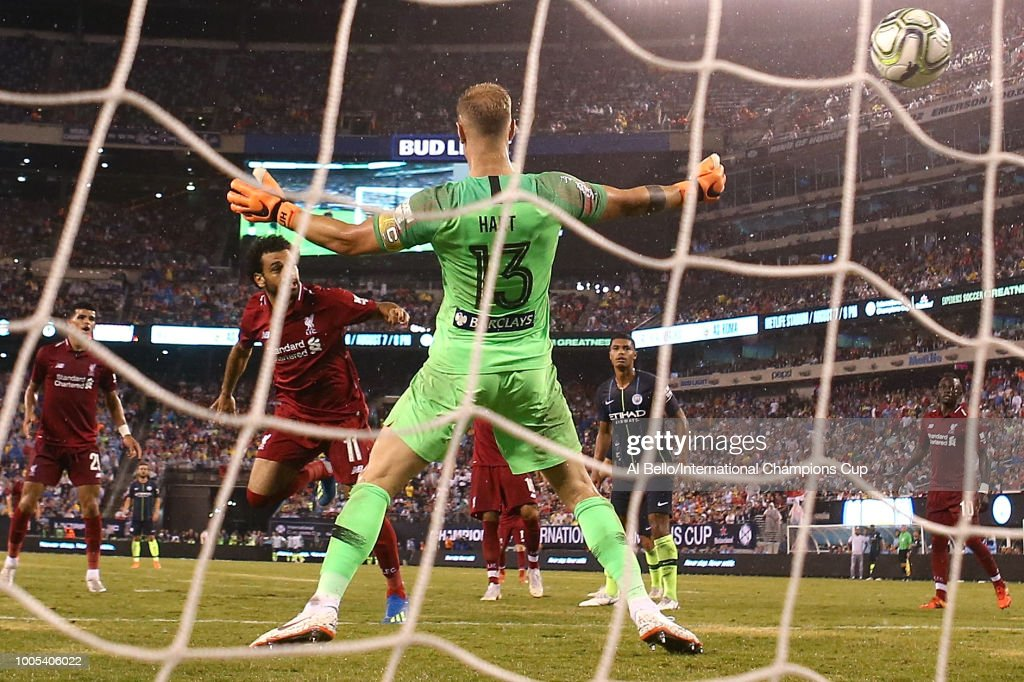 Mohamed Salah #11 of Liverpool hits a header for a goal at MetLife Stadium on July 25, 2018 in East Rutherford, New Jersey.