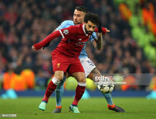 Mohamed Salah of Liverpool holds off Nicolas Otamendi of Manchester City during UEFA Champions League Quarter Final Second Leg match between...