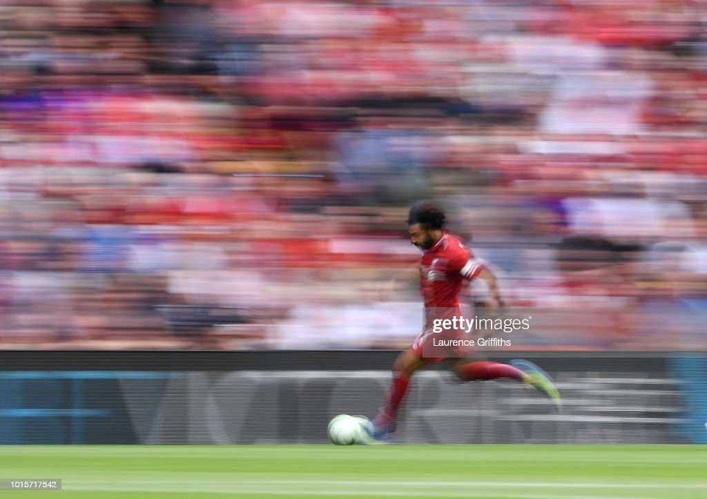 Mohamed Salah of Liverpool in action during the Premier League match between Liverpool FC and West Ham United at Anfield on August 12, 2018 in Liverpool, United Kingdom.