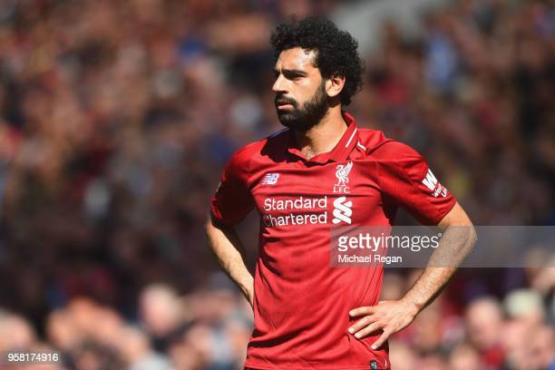 Mohamed Salah of Liverpool in action during the Premier League match between Liverpool and Brighton and Hove Albion at Anfield on May 13 2018 in...