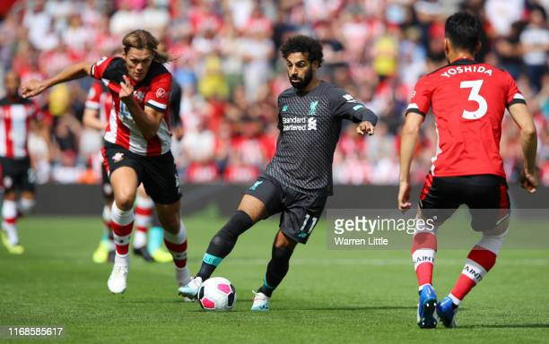 Mohamed Salah of Liverpool in action while pressured by Maya Yoshida of Southampton during the Premier League match between Southampton FC and...