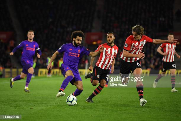 Mohamed Salah of Liverpool in action while under pressure from Ryan Bertrand of Southampton and Jannik Vestergaard of Southampton during the Premier...