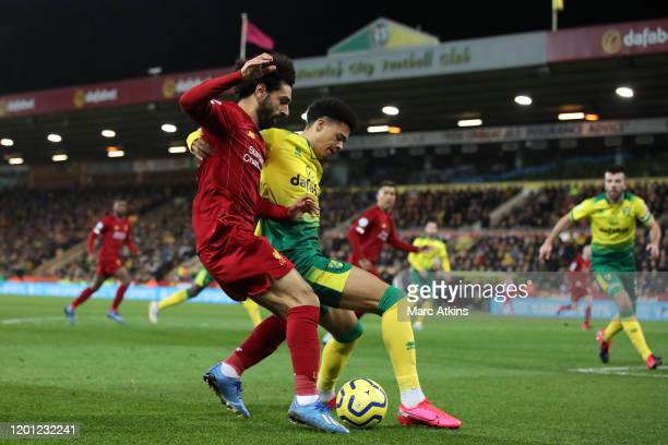 Mohamed Salah of Liverpool in action with Jamal Lewis of Norwich City during the Premier League match between Norwich City and Liverpool FC at Carrow...