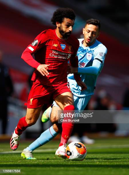 Mohamed Salah of Liverpool in action with the ball during the Premier League match between Liverpool FC and Burnley FC at Anfield on July 11 2020 in...