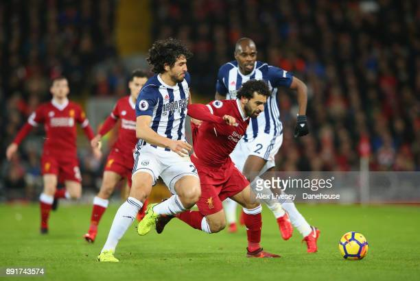 Mohamed Salah of Liverpool is challenged by Ahmed Hegazi of West Bromwich Albion during the Premier League match between Liverpool and West Bromwich...