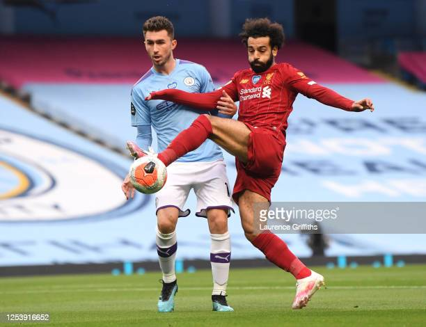 Mohamed Salah of Liverpool is challenged by Aymeric Laporte of Manchester City during the Premier League match between Manchester City and Liverpool...