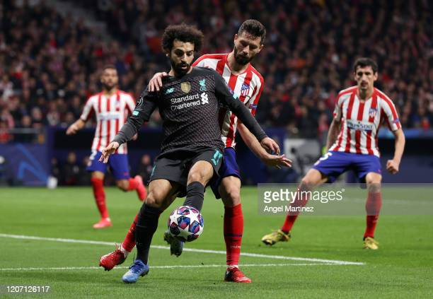 Mohamed Salah of Liverpool is challenged by Felipe of Atletico Madrid during the UEFA Champions League round of 16 first leg match between Atletico...