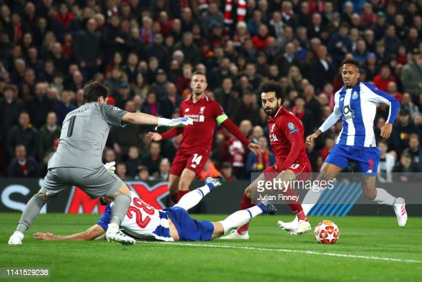 Mohamed Salah of Liverpool is challenged by Felipe of FC Porto during the UEFA Champions League Quarter Final first leg match between Liverpool and...