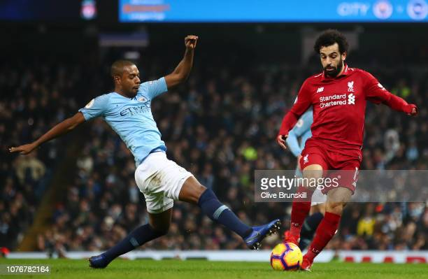 Mohamed Salah of Liverpool is challenged by Fernandinho of Manchester City during the Premier League match between Manchester City and Liverpool FC...