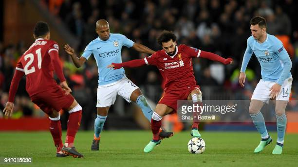 Mohamed Salah of Liverpool is challenged by Fernandinho of Manchester City during the UEFA Champions League Quarter Final Leg One match between...