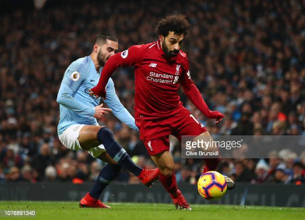 Mohamed Salah of Liverpool is challenged by Ilkay Gundogan of Manchester City during the Premier League match between Manchester City and Liverpool...