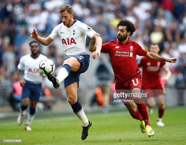 Mohamed Salah of Liverpool is challenged by Jan Vertonghen of Tottenham Hotspur during the Premier League match between Tottenham Hotspur and...