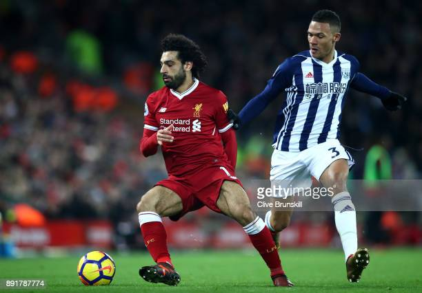Mohamed Salah of Liverpool is challenged by Kieran Gibbs of West Bromwich Albion during the Premier League match between Liverpool and West Bromwich...