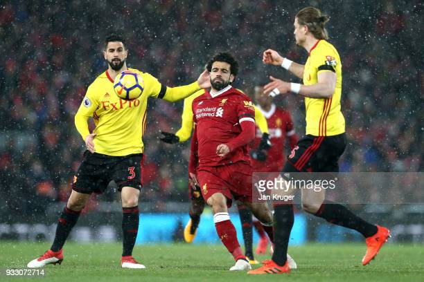 Mohamed Salah of Liverpool is challenged by Miguel Britos of Watford during the Premier League match between Liverpool and Watford at Anfield on...