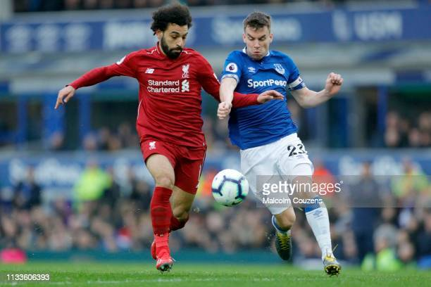 Mohamed Salah of Liverpool is challenged by Seamus Coleman of Everton during the Premier League match between Everton FC and Liverpool FC at Goodison...