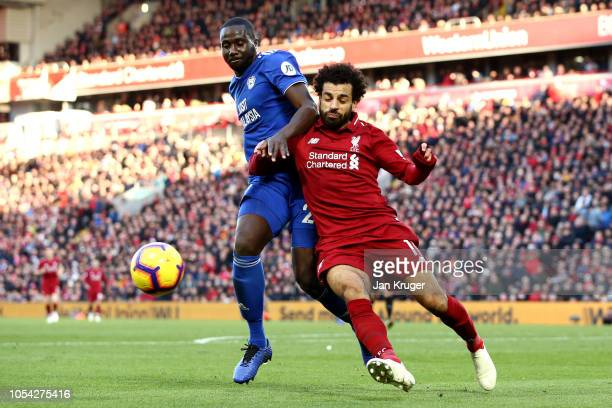 Mohamed Salah of Liverpool is challenged by Sol Bamba of Cardiff City during the Premier League match between Liverpool FC and Cardiff City at...
