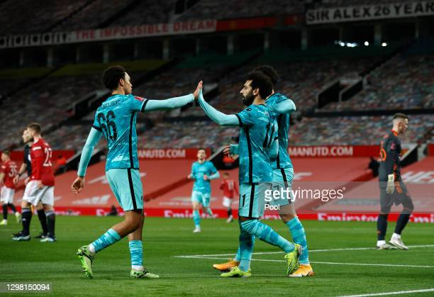 Mohamed Salah of Liverpool is congratulated by team mate Trent Alexander-Arnold after scoring their side's first goal during The Emirates FA Cup...