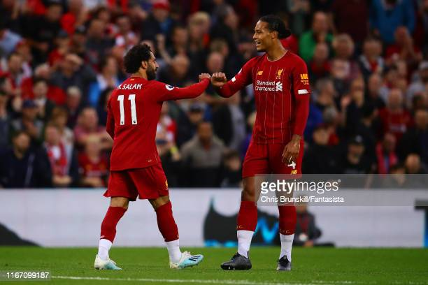Mohamed Salah of Liverpool is congratulated by teammate Virgil van Dijk after scoring his side's second goal during the Premier League match between...