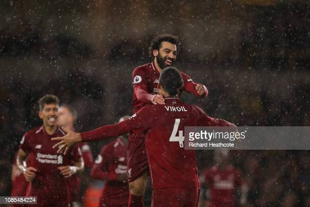 Mohamed Salah of Liverpool is congratulated by Virgil Van Dijk as he celebrates scoring the first goal during the Premier League match between...