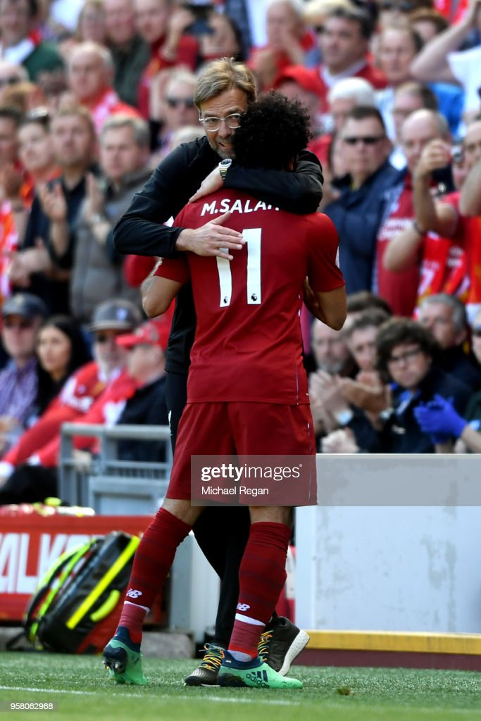 Mohamed Salah of Liverpool is embraced by Jurgen Klopp, Manager of Liverpool during the Premier League match between Liverpool and Brighton and Hove Albion at Anfield on May 13, 2018 in Liverpool, England.