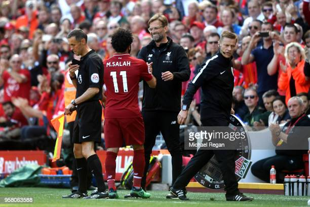 Mohamed Salah of Liverpool is embraced by Jurgen Klopp Manager of Liverpool during the Premier League match between Liverpool and Brighton and Hove...
