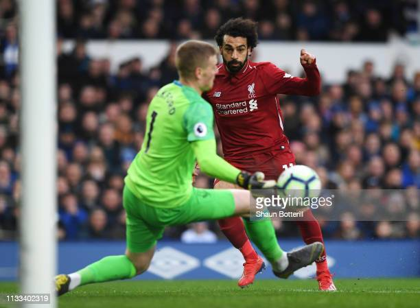 Mohamed Salah of Liverpool is foiled by Jordan Pickford of Everton as he saves during the Premier League match between Everton FC and Liverpool FC at...