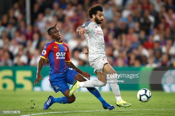 Mohamed Salah of Liverpool is fouled by Aaron WanBissaka of Crystal Palace leading to a red card during the Premier League match between Crystal...
