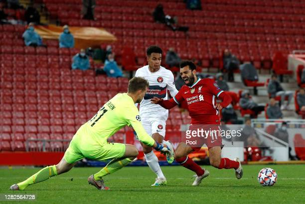 Mohamed Salah of Liverpool is fouled by Paulinho of FC Midtjylland which leads to a penalty being awarded during the UEFA Champions League Group D...
