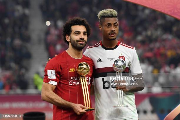 Mohamed Salah of Liverpool is presented with the Adidas Golden Ball award and Bruno Henrique of CR Flamengo is presented with the Adidas Silver Ball...