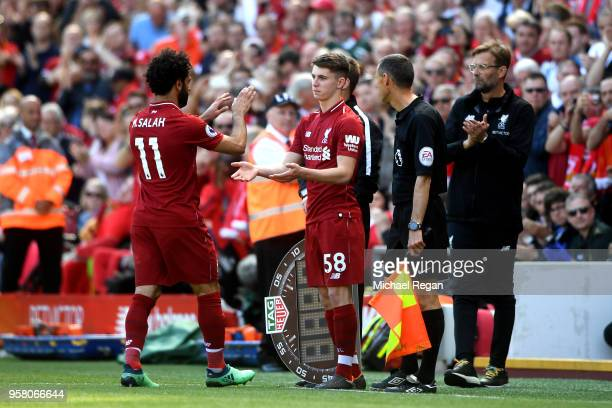 Mohamed Salah of Liverpool is sibsituted for Ben Woodburn of Liverpool during the Premier League match between Liverpool and Brighton and Hove Albion...