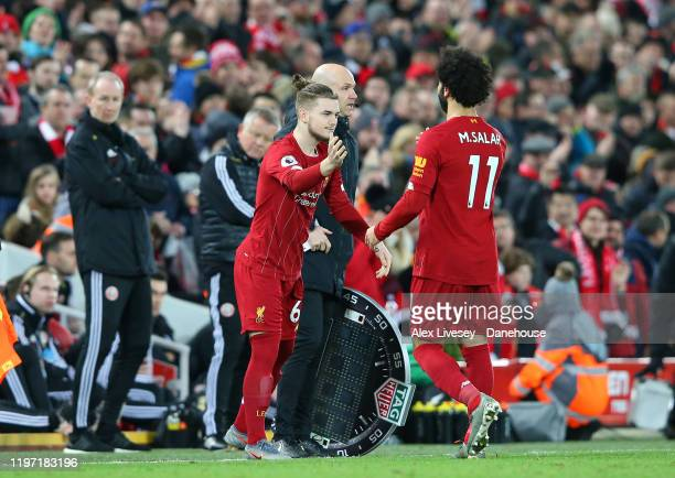 Mohamed Salah of Liverpool is substituted for Harvey Elliott during the Premier League match between Liverpool FC and Sheffield United at Anfield on...