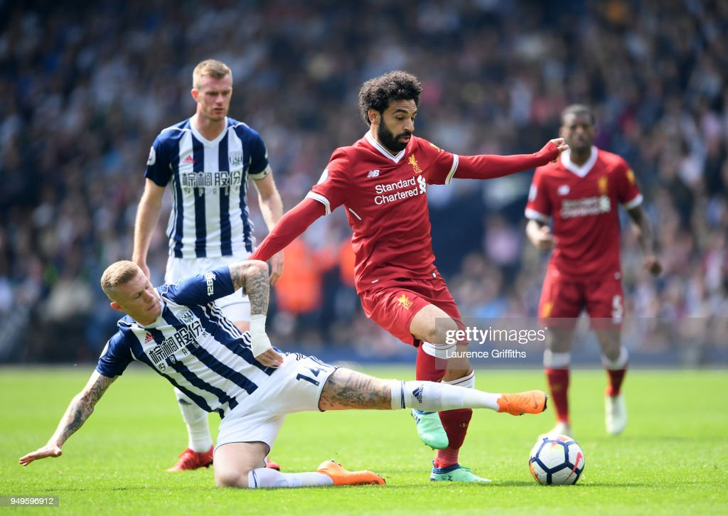 Mohamed Salah of Liverpool is tackled by James McClean of West Bromwich Albion during the Premier League match between West Bromwich Albion and Liverpool at The Hawthorns on April 21, 2018 in West Bromwich, England.