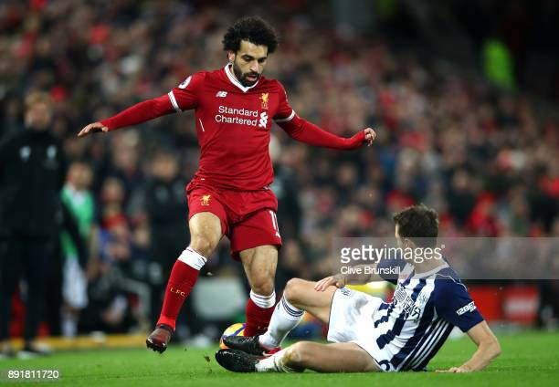 Mohamed Salah of Liverpool is tackled by Jonny Evans of West Bromwich Albion during the Premier League match between Liverpool and West Bromwich...