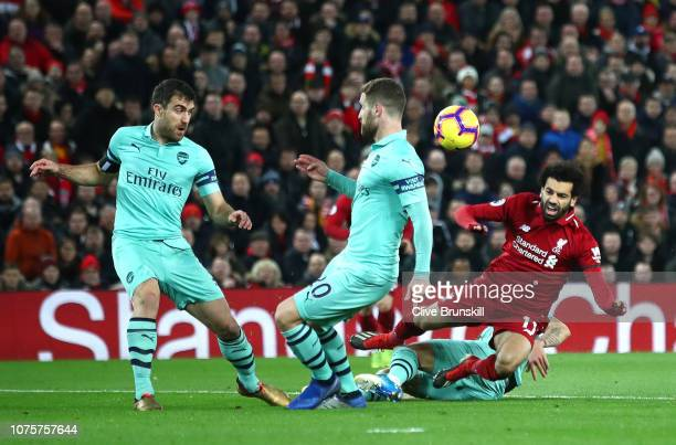 Mohamed Salah of Liverpool is tackled in the build up to the first Liverpool goal during the Premier League match between Liverpool FC and Arsenal FC...