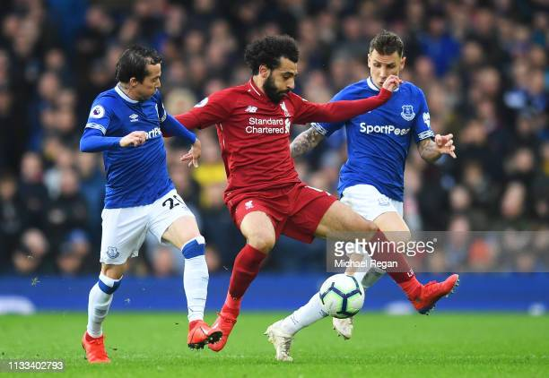Mohamed Salah of Liverpool is watched by Bernard and Lucas Digne of Everton during the Premier League match between Everton FC and Liverpool FC at...