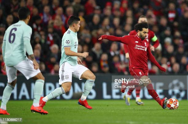 Mohamed Salah of Liverpool is watched by James Rodriguez of Bayern Munich during the UEFA Champions League Round of 16 First Leg match between...